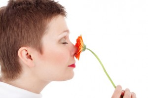 rsz_woman-smelling-flowers